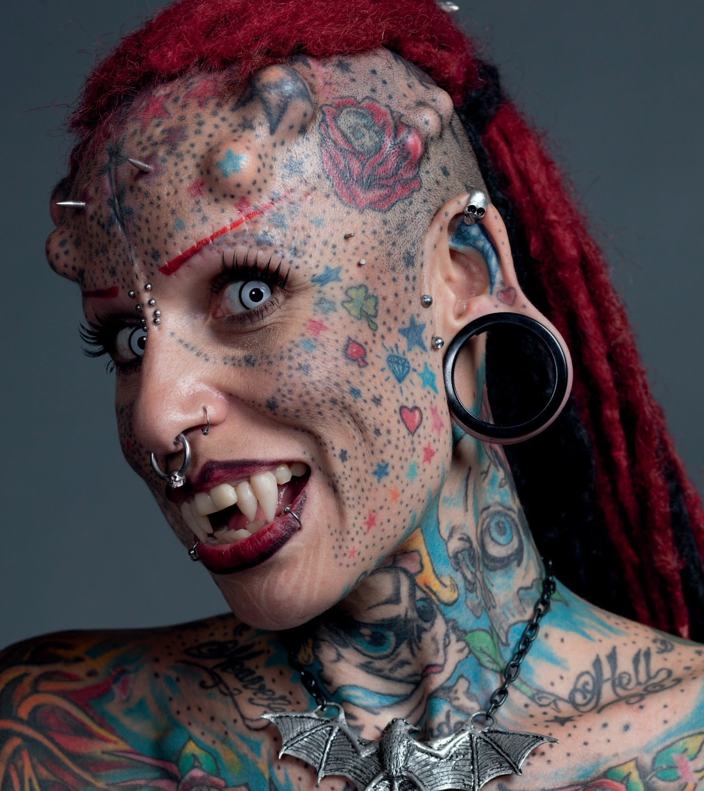 Should face modifications, <b>tattoos and piercings</b> be banned ...